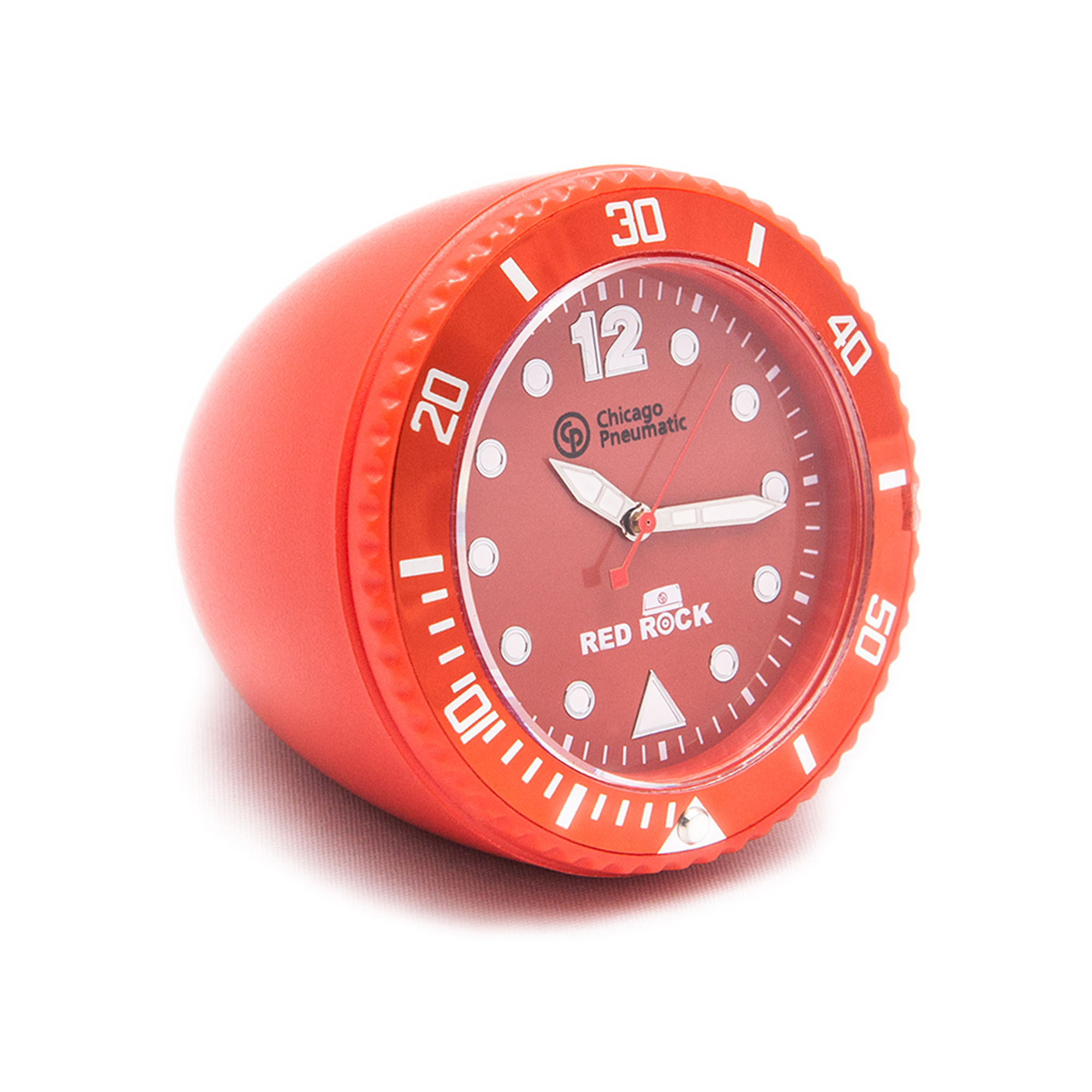 Table watch with ABS casing. Turning bezel with Aluminium top ring. Removable clock mechanism. Colored metal dial. UP relief index filled with luminous colour. Luminous metal hands. Noble Acryl glass.